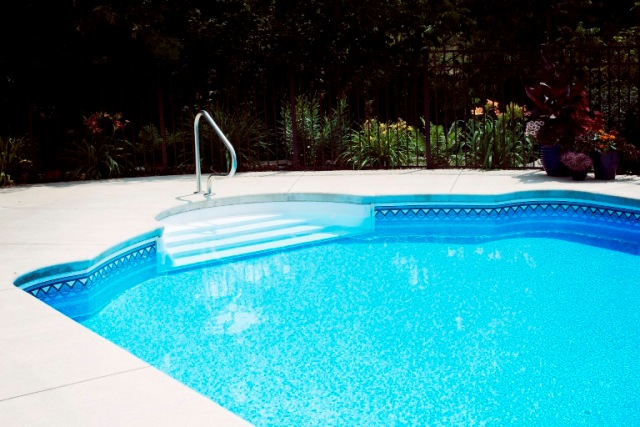 This Roman End Shaped Pool Features A Lovely Curved Shape On The Intricate Tile Work